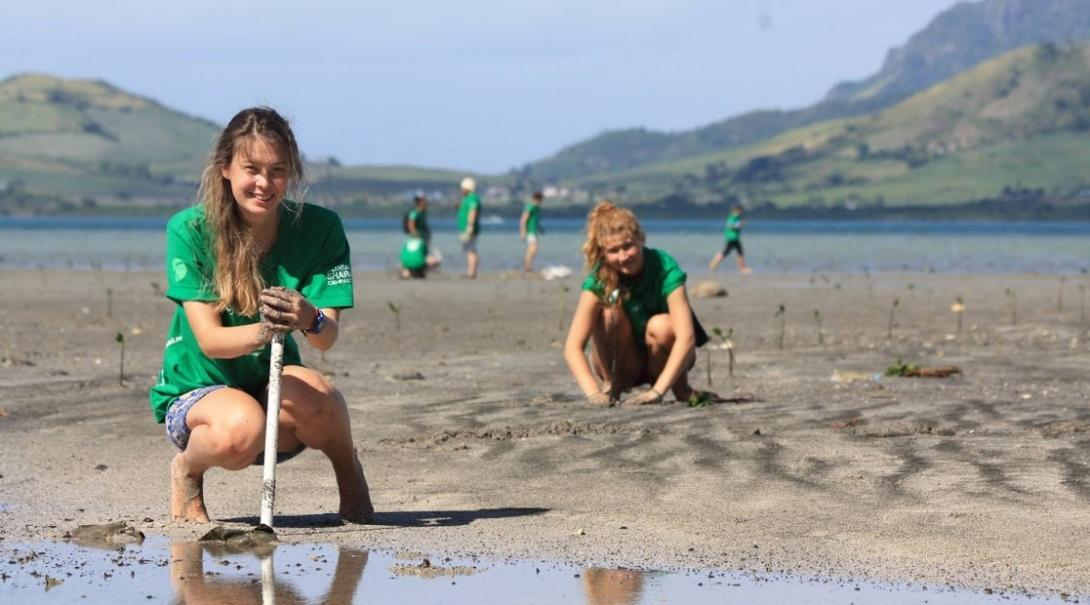 Projects Abroad volunteers travelling during their school and college years work to plant mangroves in Fiji.